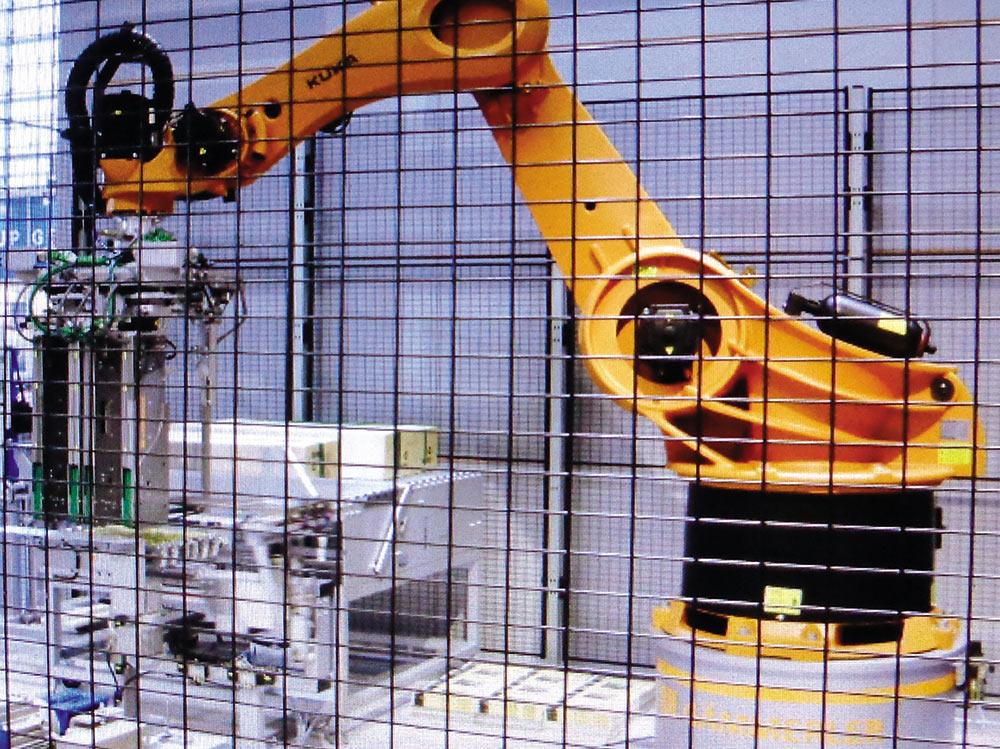 Рис. 10. Робот-укладчик KUKA на выставке drupa